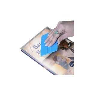 Squeegee book covering tool